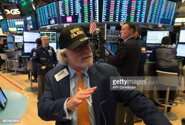 A trader wears a DOW 230000 hat while working on the floor at the closing bell of the Dow Industrial Average at the New York Stock Exchange on...