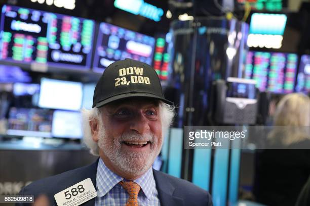 A trader wears a hat reading Dow 23000 on the floor of the New York Stock Exchange on October 17 2017 in New York City The Dow Jones Industrial...