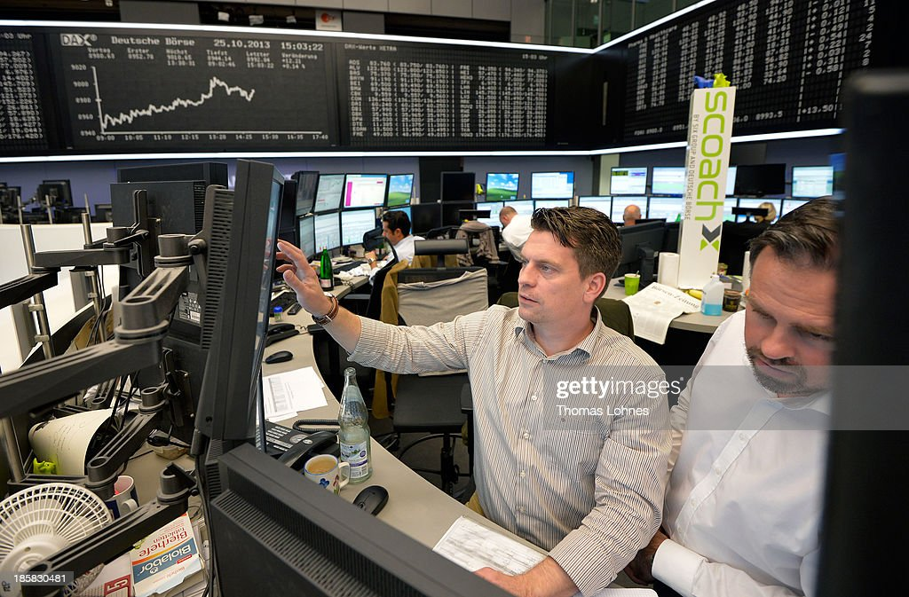 Trader work at the at the Frankfurt Stock Exchange not long after the DAX broke the 9,000 level on October 25, 2013 in Frankfurt, Germany. Today's level sets a new record for the DAX, which is the main German stock market index.