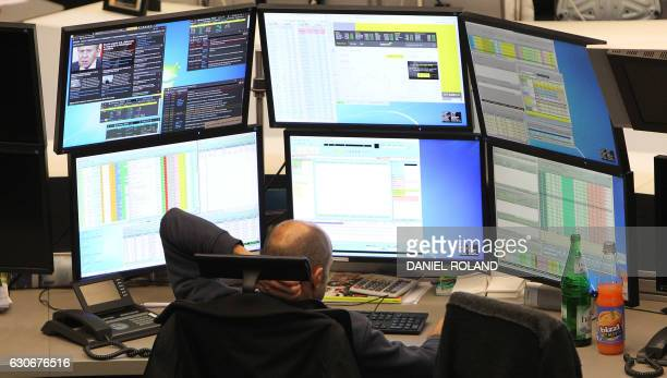 A trader works at the German Stock Exchange in Frankfurt am Main western Germany on December 30 the last day of trade of the year 2016 / AFP PHOTO /...