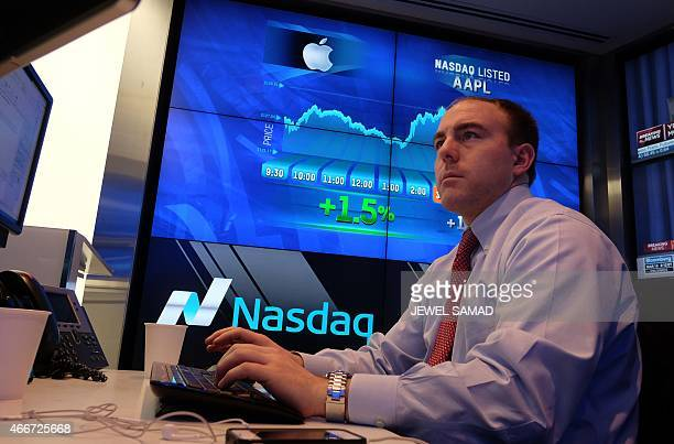 A trader works at the Nasdaq MarketSite in New York on March 18 2015 US stocks on March 18 finished mostly lower ahead of a closely watched Federal...