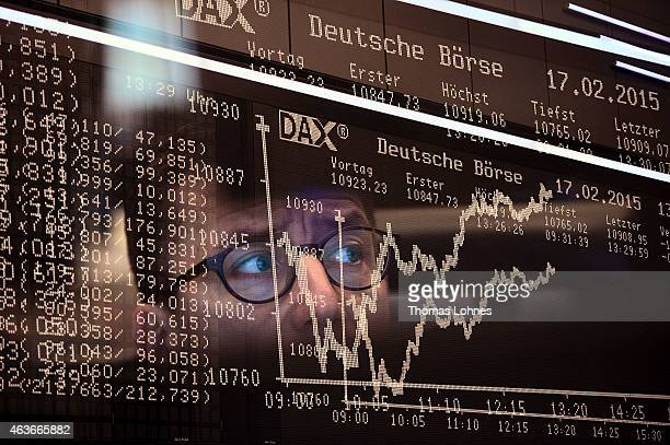 A trader works at the stock exchange in Frankfurt am Main on February 17 2015 in Frankfurt am Main Germany The DAX index recently broke the 11000...