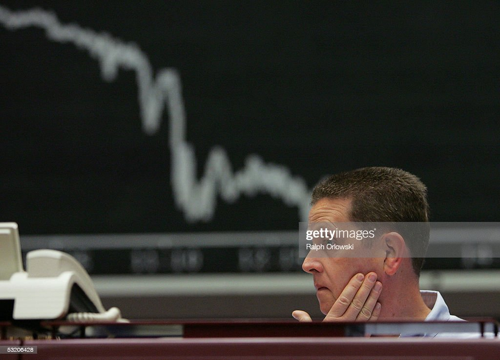 A trader works in front of the German DAX index board on the floor of Frankfurt stock exchange July 7 2005 in Frankfurt Germany Germany's DAX index...