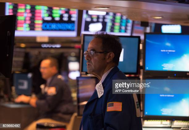 A trader works on the floor at the closing bell of the Dow Jones Industrial Average at the New York Stock Exchange on August 2 2017 in New York Wall...