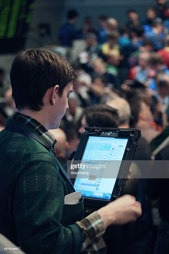 A trader works on the floor of the Chicago Board Options Exchange (CBOE) in Chicago, Illinois, U.S., on Thursday, April, 25, 2013. The CBOE opened for trading three-and-a-half hours late today after a software malfunction shut the derivatives market as its top executives were away at an industry event in Las Vegas. Photographer: Tim Boyle/Bloomberg via Getty Images
