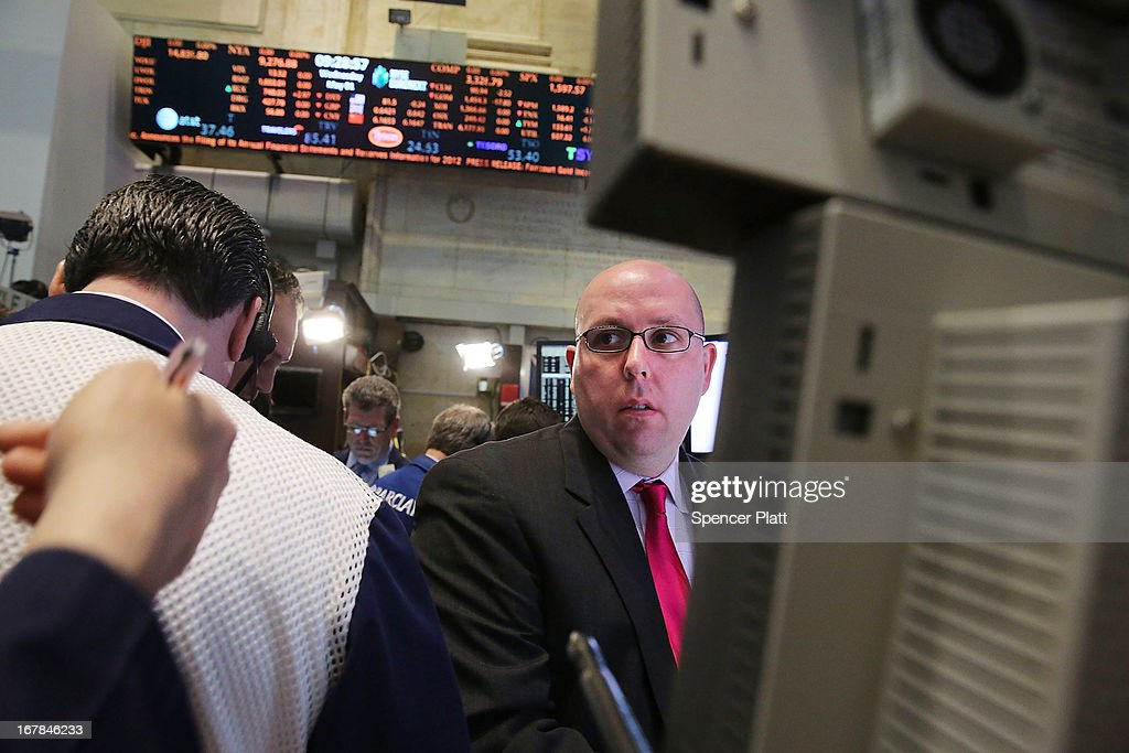 A trader works on the floor of the New York Stock Exchange after the morning bell on May 1, 2013 in New York City. As investors wait for the Federal Reserve's policy-making committee to conclude its two-day meeting, the Dow Jones industrial average, S&P 500 and the Nasdaq all declined 0.4% in morning trading.