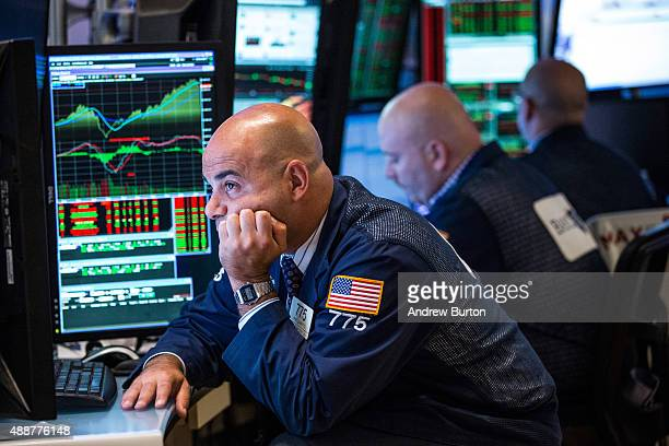 A trader works on the floor of the New York Stock Exchange after the Federal Reserve chose not raise interest rates on September 17 2015 in New York...
