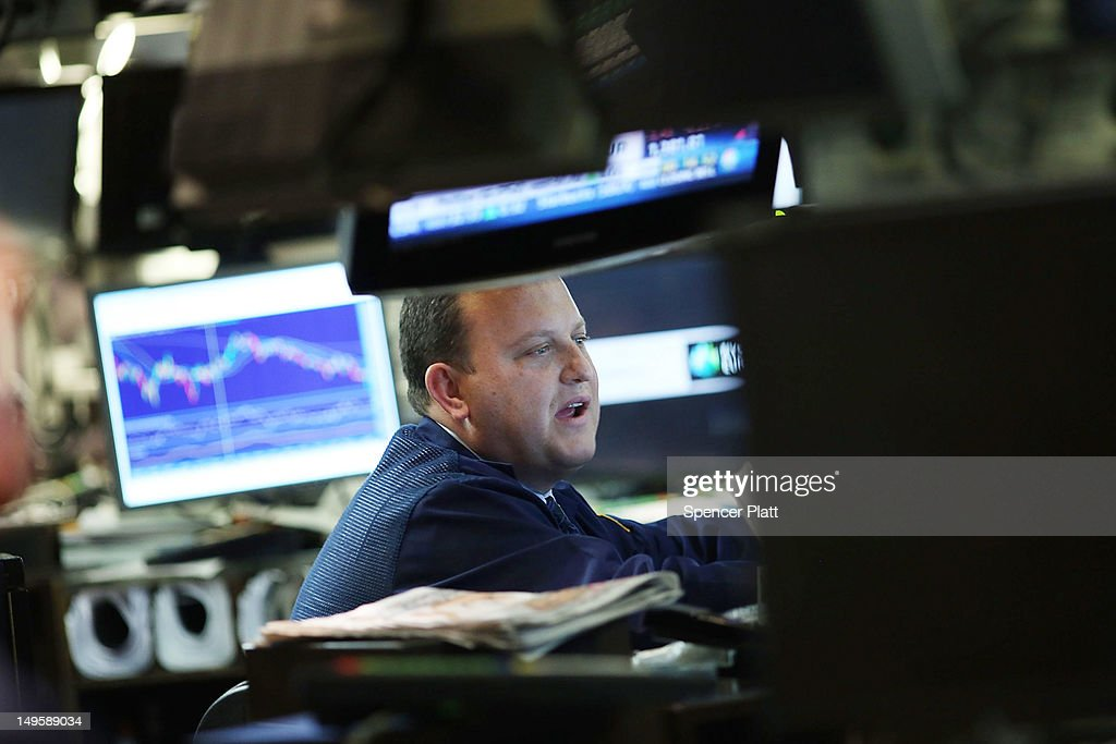 A trader works on the floor of the New York Stock Exchange at the end of the trading day at the end of the trading day on July 31, 2012 in New York City. As meetings by the U.S. and European central bankers continue, investors have been cautious as they await an outcome of the talks as early as Wednesday.The Dow Jones Industrial Average slipped 64 points, or 0.5%.
