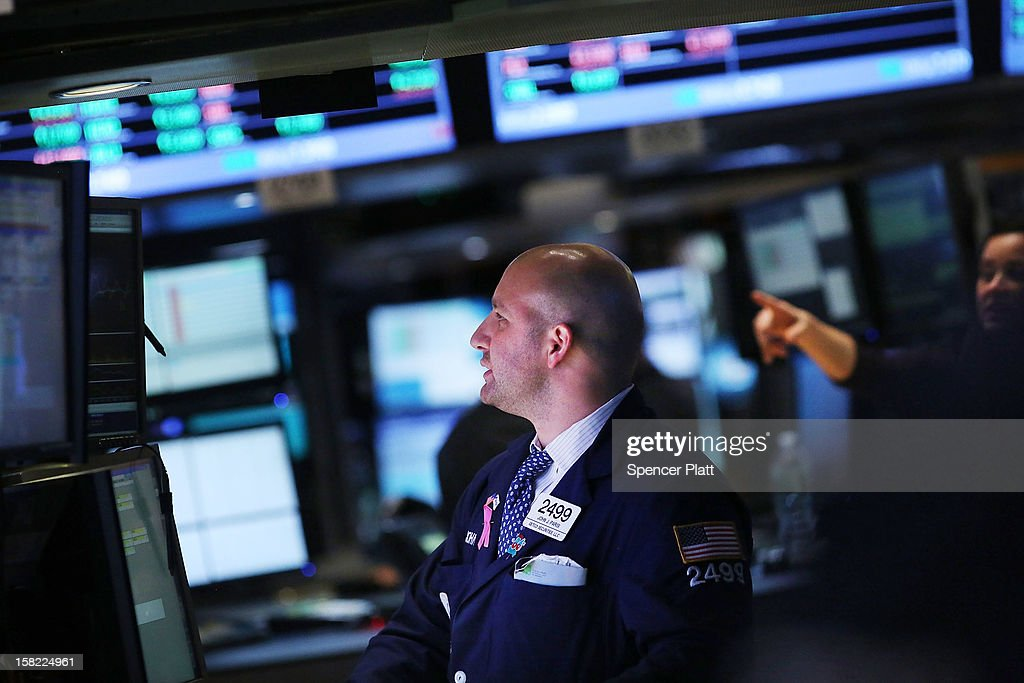 A trader works on the floor of the New York Stock Exchange at the end of the day on December 11, 2012 in New York City. With expectations that the Federal Reserve may announce more stimulus measures by the end of the year, the U.S. Stock Market moved higher Tuesday. The Dow Jones industrial average rose 0.6 percent with the the S&P 500 rising 0.65 percent.