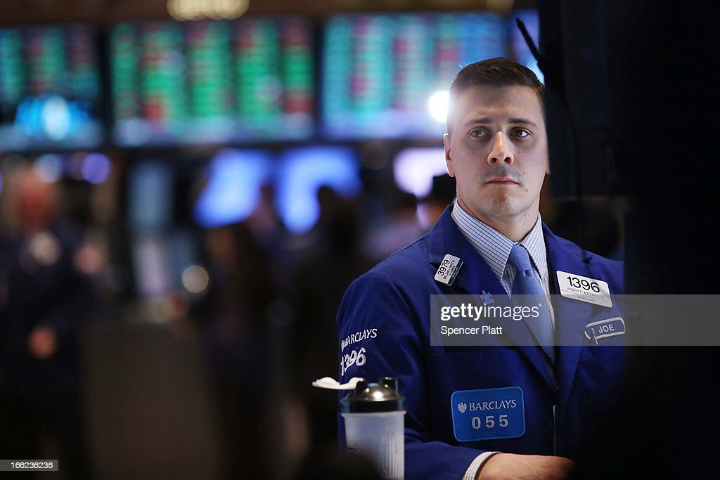 A trader works on the floor of the New York Stock Exchange at the end of the trading day on April 10, 2013 in New York City. The Dow Jones industrial average hit a new trading high of 14,826.66 Wednesday, moving up 0.9%.