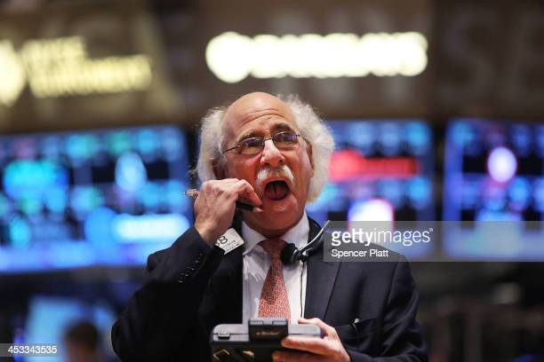 A trader works on the floor of the New York Stock Exchange at the end of the trading day on December 3 2013 in New York City As many investors stay...