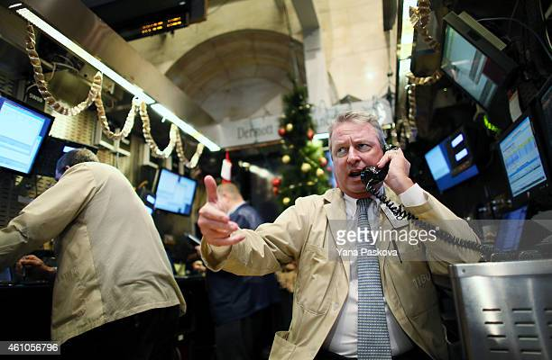 A trader works on the floor of the New York Stock Exchange at the end of the trading day on January 05 2015 in New York City US stocks fell over 330...
