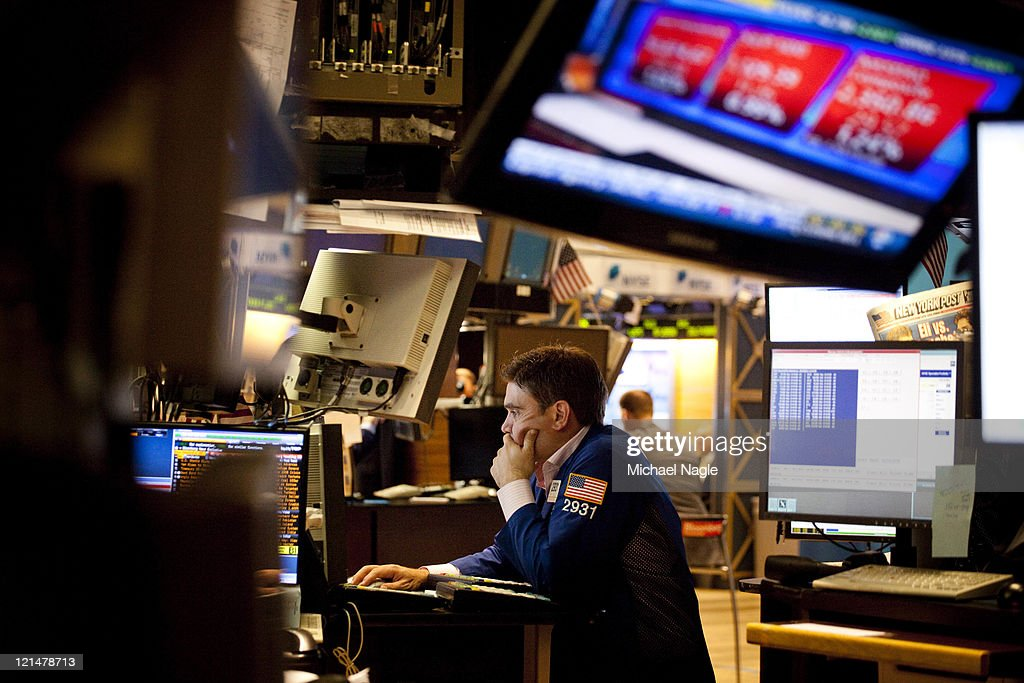 A trader works on the floor of the New York Stock Exchange before the closing bell on August 19, 2011 in New York City. The Dow ends another volatile week, closing more than 100 points down for the day.