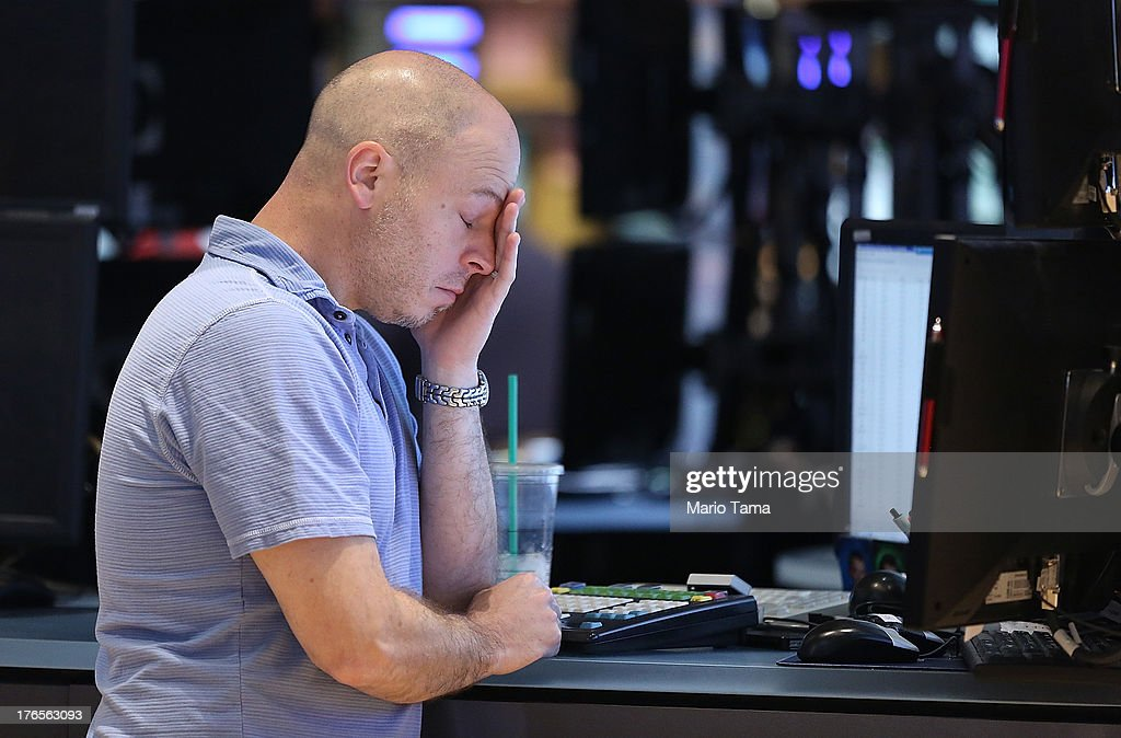 A trader works on the floor of the New York Stock Exchange before the closing bell on August 15, 2013 in New York City. Stocks dropped on weak earnings as the Dow fell 225 points to close at 15,112.19.