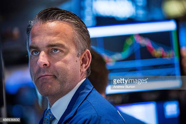 A trader works on the floor of the New York Stock Exchange during afternoon trading October 9 2014 in New York City The Dow Jones Industrial Average...