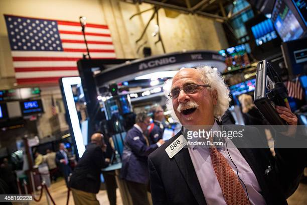 A trader works on the floor of the New York Stock Exchange during the afternoon of October 31 2014 in New York City The Dow Jones Industrial Average...