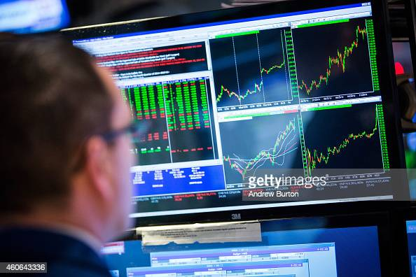 A trader works on the floor of the New York Stock Exchange during the afternoon of December 18 2014 in New York City The stock market had its best...