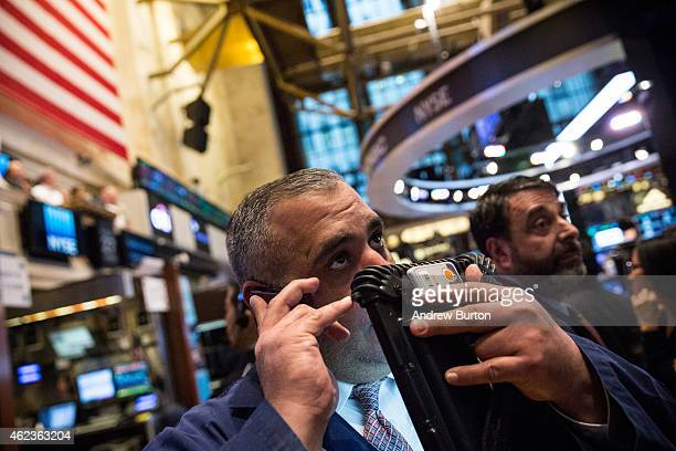 A trader works on the floor of the New York Stock Exchange during the afternoon of January 27 2015 in New York City The Dow Jones Industrial Average...