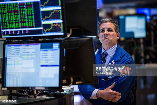 A trader works on the floor of the New York Stock Exchange during the afternoon of April 15 2015 in New York City The Dow Jones Industrial Average...
