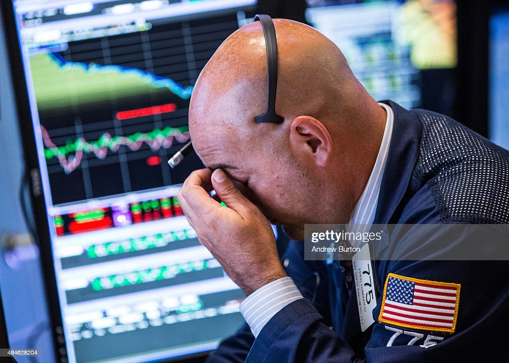 A trader works on the floor of the New York Stock Exchange during the afternoon of August 20 2015 in New York City The Dow Jones continued its plunge...