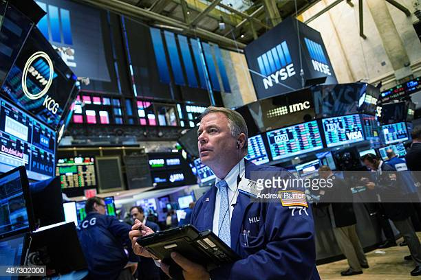A trader works on the floor of the New York Stock Exchange during the afternoon of September 8 2015 in New York City The Dow jumped nearly 400 points...