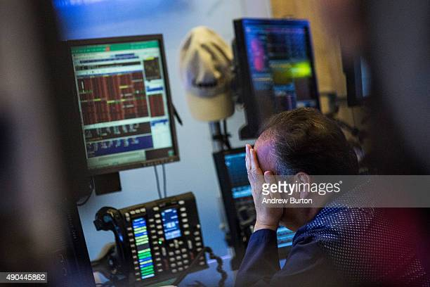 A trader works on the floor of the New York Stock Exchange during the afternoon of September 28 2015 in New York City Stocks plunged nearly 300...