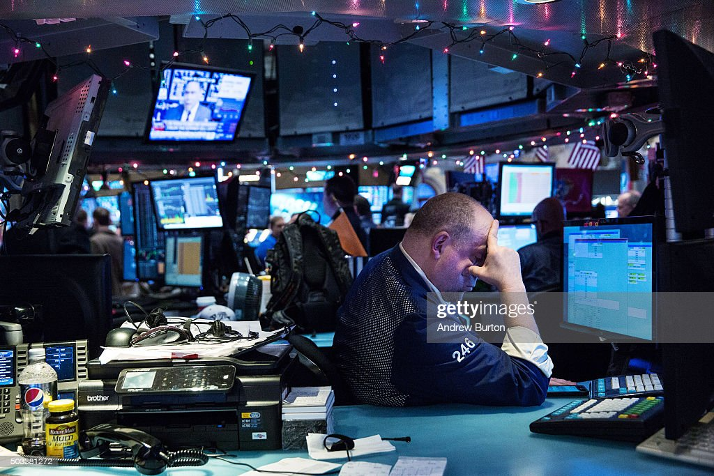 A trader works on the floor of the New York Stock Exchange during the afternoon of January 4 2016 in New York City Today marks the first day of...