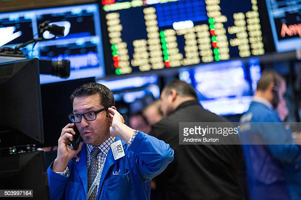 A trader works on the floor of the New York Stock Exchange during the morning of January 8 2016 in New York City US markets have declined over the...