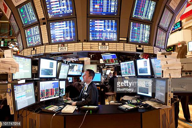 A trader works on the floor of the New York Stock Exchange in New York US on Monday June 7 2010 US stocks fell sending benchmark indexes to...