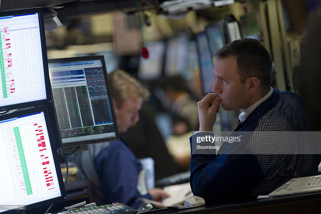 A trader works on the floor of the New York Stock Exchange in New York, U.S., on Thursday, June 2, 2011. U.S. stocks retreated, a day after the biggest slump for the Standard & Poor's 500 Index since August, as investors awaited the Labor Department's monthly report on employment in the world's largest economy. Photographer: Jin Lee/Bloomberg via Getty Images