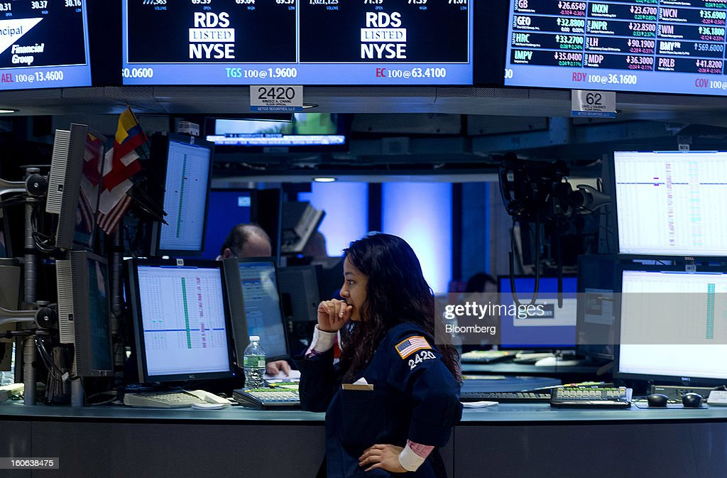A trader works on the floor of the New York Stock Exchange (NYSE) in New York, U.S., on Monday, Feb. 4, 2013. U.S. stocks fell, after the Standard & Poor's 500 Index jumped to a five-year high, on concern over increasing political tension in Europe as investors awaited data on factory orders. Photographer: Jin Lee/Bloomberg via Getty Images