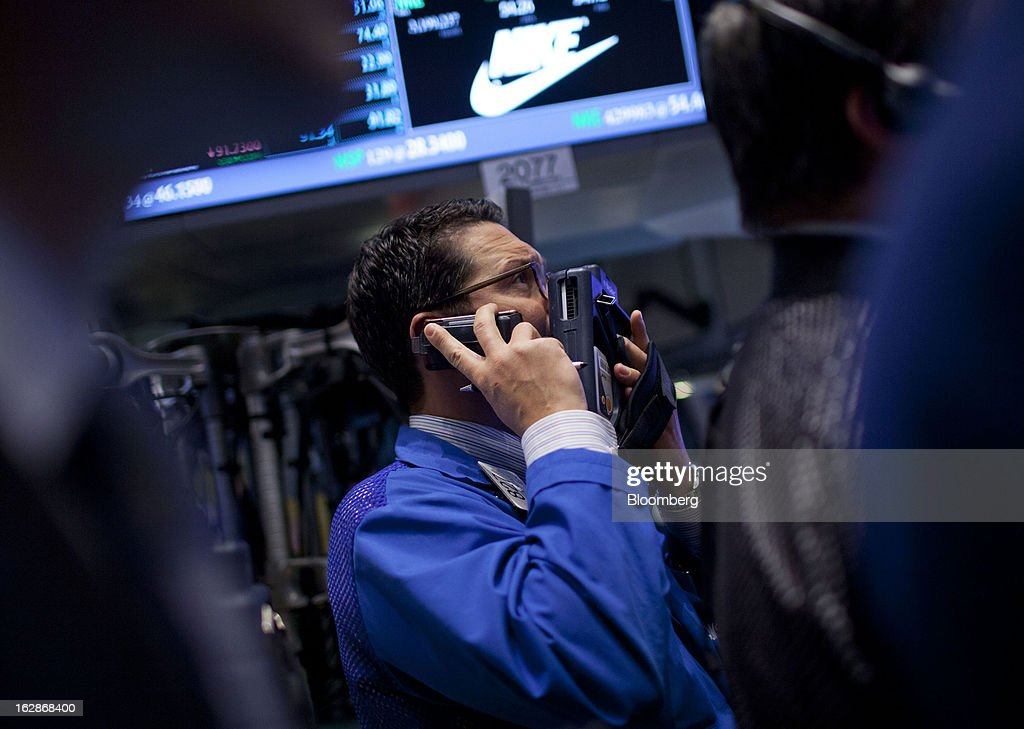 A trader works on the floor of the New York Stock Exchange (NYSE) in New York, U.S., on Thursday, Feb. 28, 2013. U.S. stocks erased gains in the final half hour of trading after the Senate rejected a pair of partisan proposals to replace $85 billion in automatic spending cuts scheduled to start tomorrow. Photographer: Jin Lee/Bloomberg via Getty Images