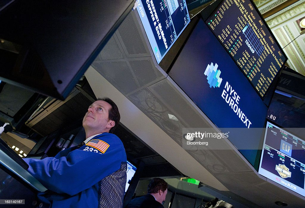 A trader works on the floor of the New York Stock Exchange (NYSE) in New York, U.S., on Tuesday, March 5, 2013. Stocks rallied, sending the Dow Jones Industrial Average to a record, and metals climbed as China vowed to maintain its growth target and investors bet central banks will continue stimulus measures. Photographer: Jin Lee/Bloomberg via Getty Images