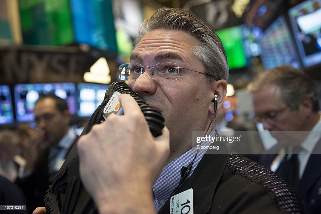 A trader works on the floor of the New York Stock Exchange (NYSE) in New York, U.S., on Wednesday, April 24, 2013. U.S. stocks were little changed, after the Standard & Poor's 500 Index gained for a third day, as investors watched earnings at companies from Boeing Co. to Apple Inc. Photographer: Scott Eells/Bloomberg via Getty Images