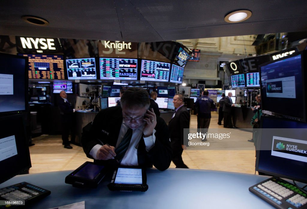 A trader works on the floor of the New York Stock Exchange (NYSE) in New York, U.S., on Friday, May 10, 2013. U.S. stocks rose, with the Standard & Poor's 500 Index poised for a third straight week of gains, as investors weighed the pace of central bank stimulus amid a meeting of finance ministers. Photographer: Jin Lee/Bloomberg via Getty Images
