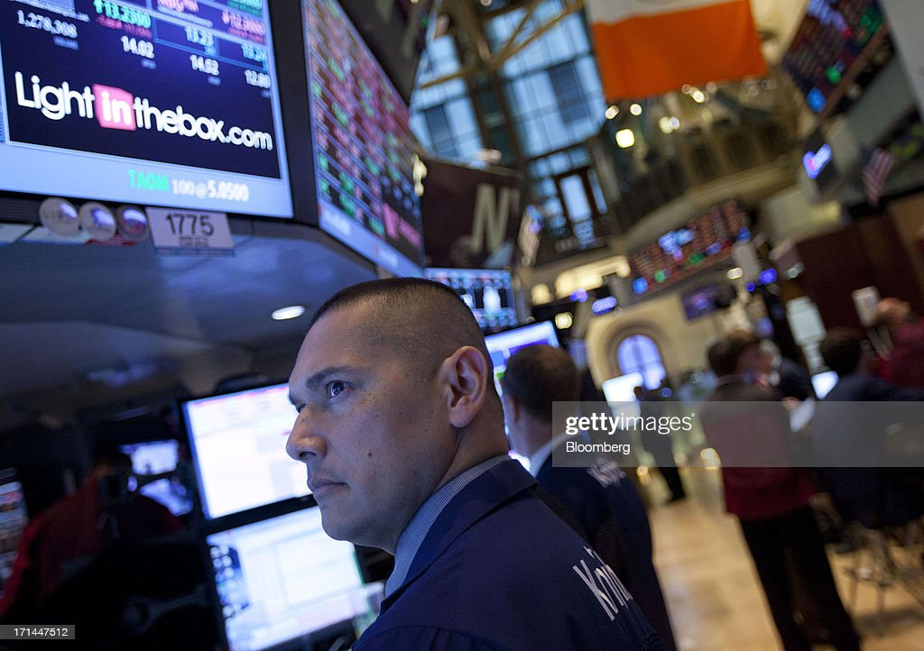 A trader works on the floor of the New York Stock Exchange (NYSE) in New York, U.S., on Monday, June 24, 2013. U.S. stocks fell after Chinese equities entered a bear market on concern a cash crunch will hurt growth. Treasuries pared losses on speculation investors overreacted to a possible reduction of central bank stimulus. Photographer: Jin Lee/Bloomberg via Getty Images