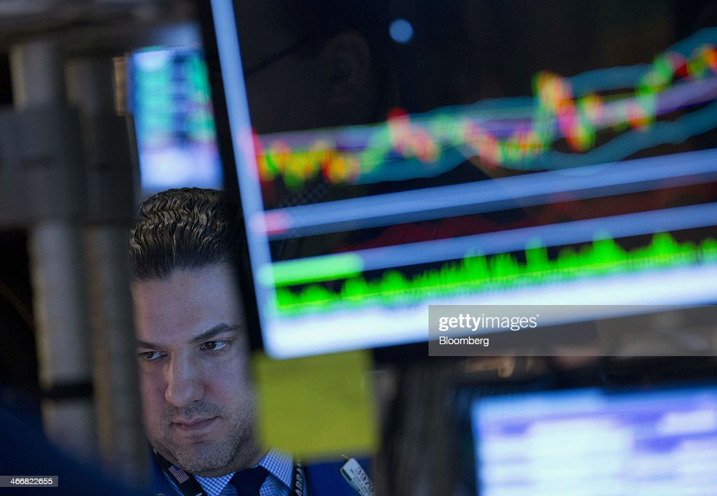 A trader works on the floor of the New York Stock Exchange (NYSE) in New York, U.S., on Tuesday, Feb. 4, 2014. U.S. stocks rose, with the Standard & Poor's 500 Index rebounding after the biggest drop since June, as Treasuries retreated and South Africa's rand led emerging-market currencies higher. Photographer: Jin Lee/Bloomberg via Getty Images