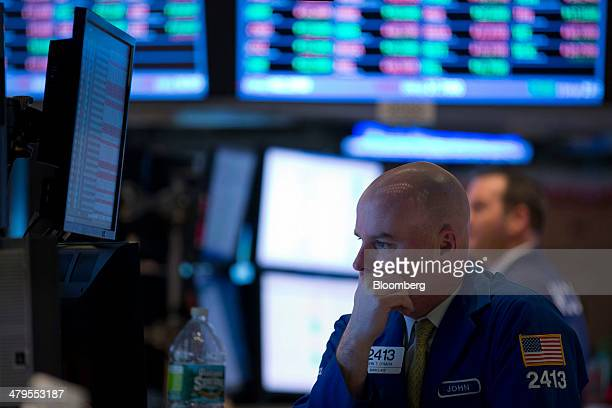 A trader works on the floor of the New York Stock Exchange in New York US on Wednesday March 19 2014 US stocks fell as the Federal Reserve reduced...