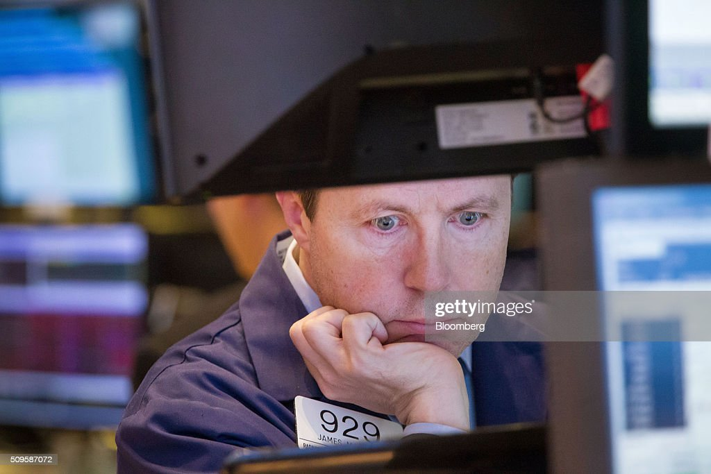 A trader works on the floor of the New York Stock Exchange (NYSE) in New York, U.S., on Thursday, Feb. 11, 2016. Global equities tumbled toward a bear market, with the Dow Jones Industrial Average plunging to 400 points, as financial markets signaled that investors have lost faith in central banks' ability to support the worldwide economy. Photographer: Michael Nagle/Bloomberg via Getty Images