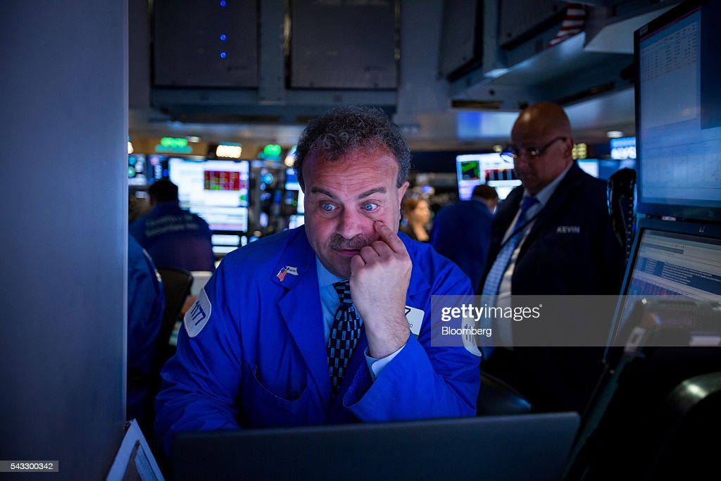 A trader works on the floor of the New York Stock Exchange (NYSE) in New York, U.S., on Monday, June 27, 2016. U.S. stocks resumed a selloff sparked by Britain's shock vote to leave the European Union, with the Dow Jones Industrial Average falling more than 300 points after equities on Friday tumbled the most in 10 months. Photographer: Michael Nagle/Bloomberg via Getty Images