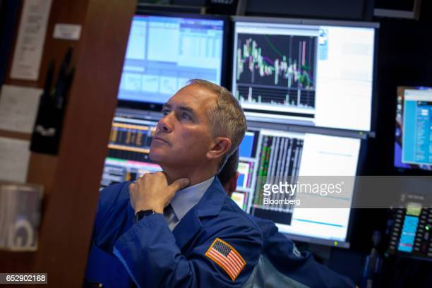 A trader works on the floor of the New York Stock Exchange in New York US on Monday March 13 2017 US stocks held steady as they kicked off a week...