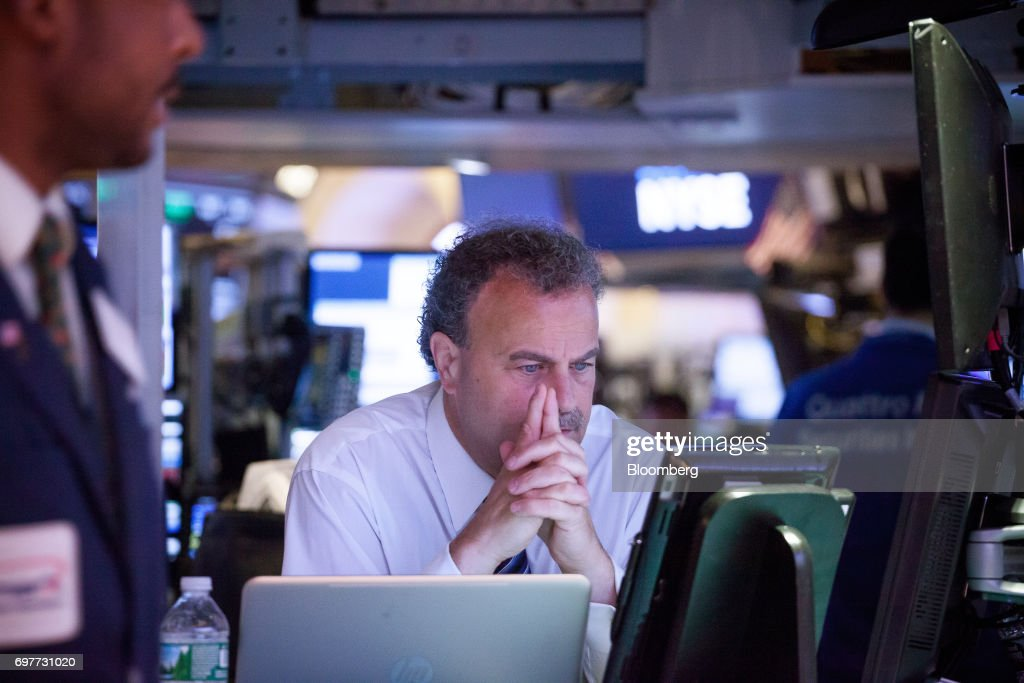 A trader works on the floor of the New York Stock Exchange (NYSE) in New York, U.S., on Monday, June 19, 2016. U.S. stocks rose, following a lull in markets after equities hit another fresh record last week. Photographer: Michael Nagle/Bloomberg via Getty Images
