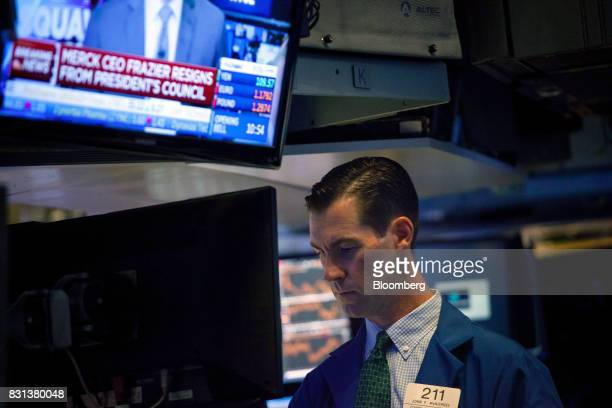 A trader works on the floor of the New York Stock Exchange in New York US on Monday Aug 14 2017 US stockindex futures advanced and volatility...