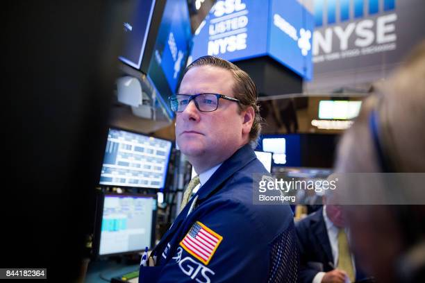 A trader works on the floor of the New York Stock Exchange in New York US on Friday Sept 8 2017 The dollar fell to the weakest in more than two years...