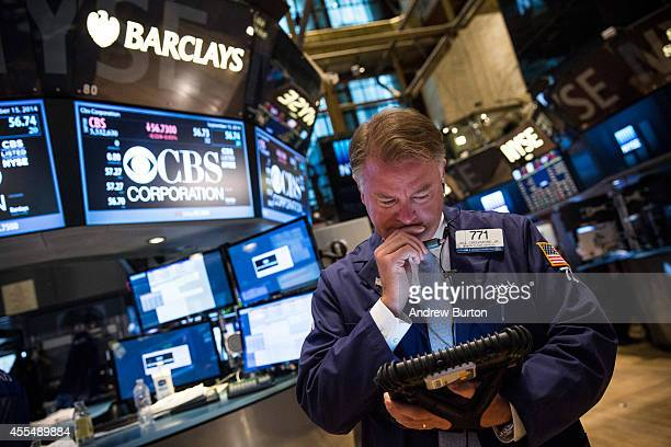 A trader works on the floor of the New York Stock Exchange on Septemeber 15 2014 in New York City The Dow Jones Industrial Average rose 43 points and...