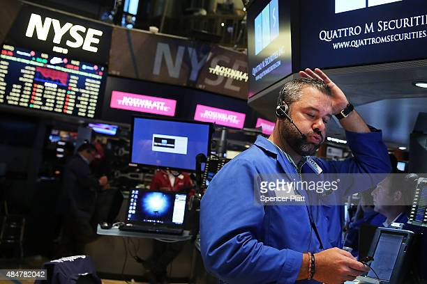 A trader works on the floor of the New York Stock Exchange on August 21 2015 in New York City The Dow fell over 500 points in trading today as global...