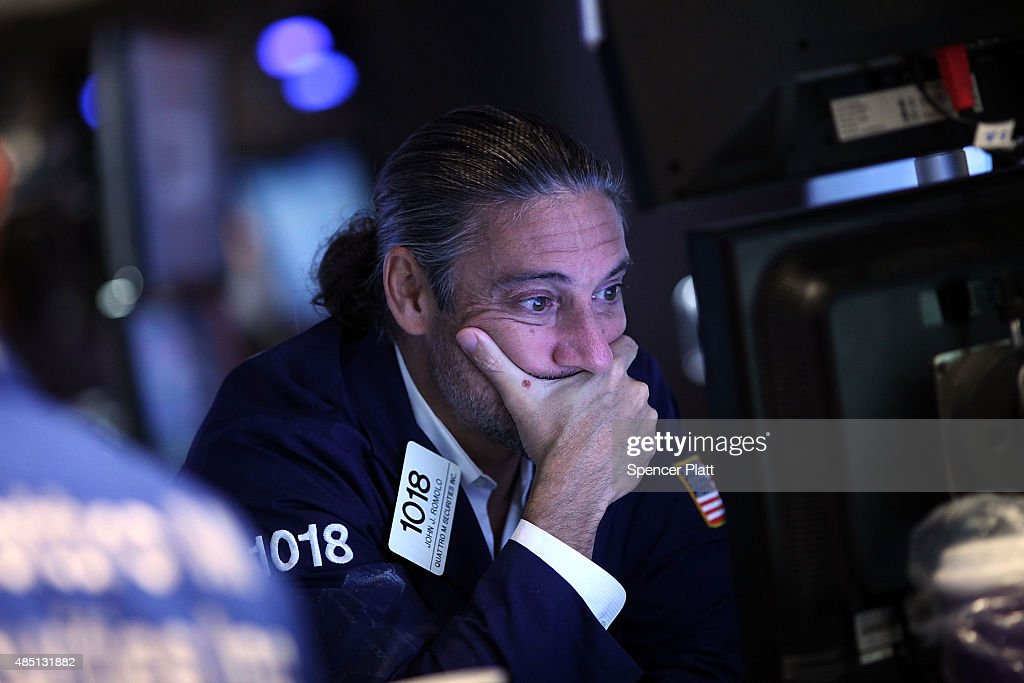 A trader works on the floor of the New York Stock Exchange on August 24 2015 in New York City As the global economy continues to react from events in...