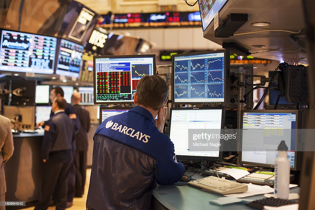 A trader works on the floor of the New York Stock Exchange on February 4, 2013 in New York City. Stocks dropped sharply today following the Dow's close last week above 14000.