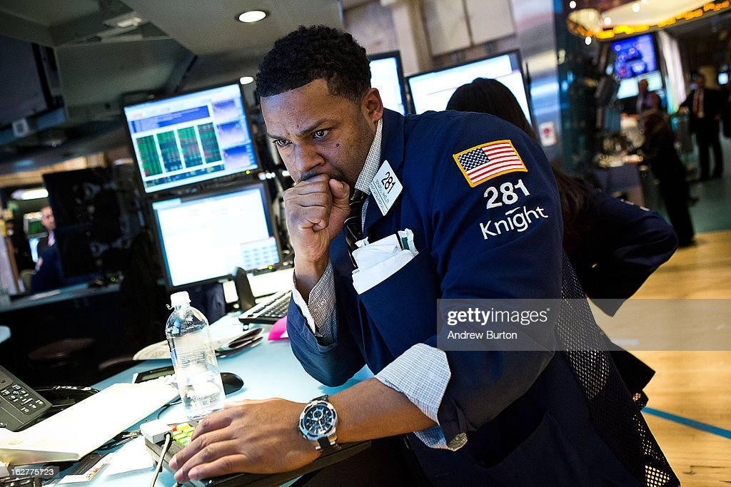A trader works on the floor of the New York Stock Exchange on February 26, 2013 in New York City. The markets rose today, as the Federal Reserve announced stimulus efforts would continue.