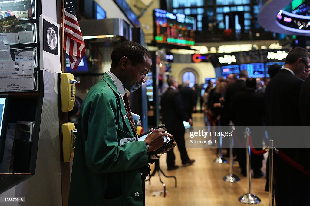 A trader works on the floor of the New York Stock Exchange on January 2, 2013 in New York City. A day after U.S. lawmakers reached a last minute agreement to avert the fiscal cliff, U.S. stocks surged as traders around the globe felt renewed confidence over global markets. Shortly after the opening bell, The Dow Jones Industrial Average rallied more than 230 points, or 1.7%.
